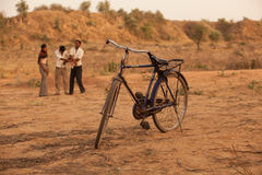 Indian Bicycle with boys behind playing Royalty Free Stock Photos