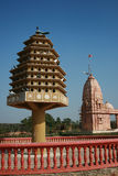 Indian Bird House. Bird House and Indian temple in the background. The bird house is for pigeons stock photography