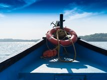 In indian boat near beach landscape backdrop. Horizon goa red blue horizontal orientation nobody blank empty space sparse vivid vibrant bright color rich stock images