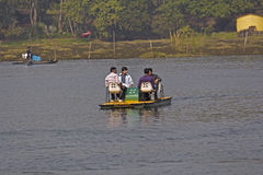 Indian boating. JANUARY 26, 2014, NANDANKANAN ZOO, BETWEEN BHUBANESHWAR AND CUTTACK, ORISSA, INDIA - Four Indians boats on the lake in Nandankanan zoo Royalty Free Stock Images
