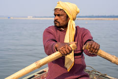Indian Boatman Rowing on the Ganges River, Varanasi, India Royalty Free Stock Photo