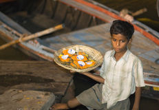 Varanasi, India, Indian Boy selling Aarti Royalty Free Stock Photography
