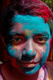 Indian boy covered with paint Royalty Free Stock Photos