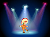An Indian boy dancing with spotlights Stock Images