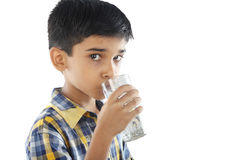 Indian boy drinking water Stock Photo