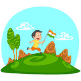 Indian boy hoisting flag of India Royalty Free Stock Images
