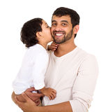 Indian boy kissing dad. Indian boy kissing his dad isolated on white background Royalty Free Stock Images