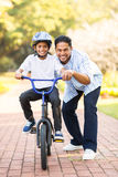 Indian boy learning bike Royalty Free Stock Photos