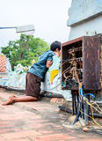 Indian boy near chaotic electrical wiring Stock Image