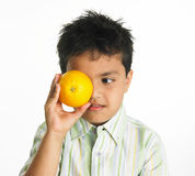Indian boy with orange Royalty Free Stock Images