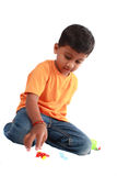 Indian Boy Playing Royalty Free Stock Image