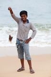 Indian boy with poison lionfish Stock Images