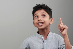 Indian boy. Portrait of an Indian boy with an expression when he gets an idea or solution stock image