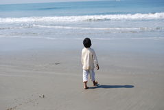 An Indian boy on the seashore Stock Photos