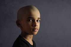 Indian Boy with Shaved Head. Portrait of Indian Boy with Shaved Head Royalty Free Stock Photo