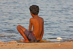 Indian Boy sitting near the river Royalty Free Stock Images