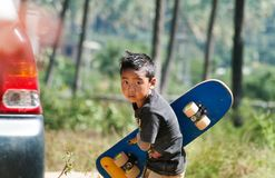 Indian boy with skateboard on the street in Bangalore stock photos