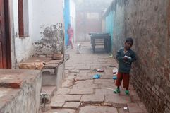 Indian boy on the street cold foggy winter morning in Varanasi Royalty Free Stock Photography