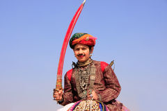 Indian boy with a sword taking part in Desert Festival, Jaisalme Royalty Free Stock Image