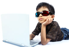 Indian boy using a laptop. With 3d Glasses Royalty Free Stock Photography