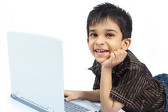 Indian Boy using laptop Stock Photo