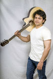Indian boy in white tshirt holding guitar Royalty Free Stock Image