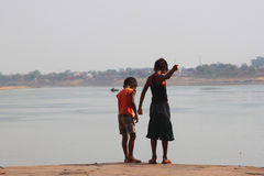 Indian Boys Fishing. Two boys fishing with whatever they could find, this time it happens to be a small piece of thread Stock Photography