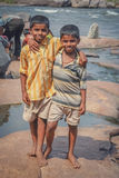 Indian boys. Posing for a photo on the riverbank in Hampi, India Royalty Free Stock Photos