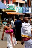 Indian brahmins walking in the temple street Royalty Free Stock Photo