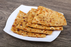 Indian bread roti. On the plate in wood background Stock Images