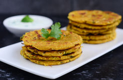 Indian breakfast consisting of parantha and curd royalty free stock photography