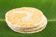 Indian breakfast Dosa served on banana leaf. Stock Photos