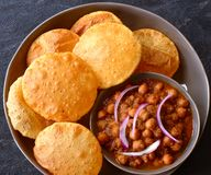 Indian vegan meal -Chole Puri. Indian breakfast meal consisting of chole and puris as the main dish. bhatura bhature birthday bowl bread brekkie chana channa stock photography