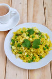Indian breakfast Poha. Served with Tea royalty free stock photo