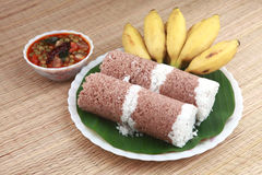 Indian breakfast. Puttu with curry and a bunch of banana Stock Photography