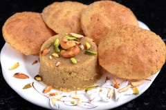 Indian breakfast. Semolina fudge with fried flat bread also called sooji halwa poori or sheera puri in Indian cities.Very common street food for breakfast in Royalty Free Stock Photos