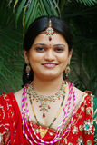 Indian Bride. A smiling indian bride wearing traditional outfit and jewellery at her wedding Stock Images