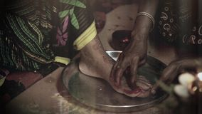Indian bride doing hindu ritual of foot coloring. stock footage