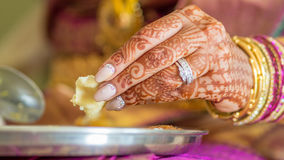 Indian bride eating Stock Photography