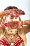 Beautiful Indian Bride with Mehendi hands or Henna stock photos