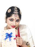 Indian bride with a gift box Stock Photography