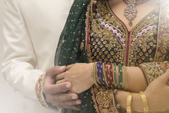 Indian bride and Groom. Bride and groom holding hands Royalty Free Stock Image