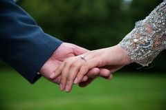 Indian bride and groom holding hands Royalty Free Stock Photo