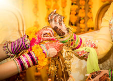 Indian bride hands getting decorated. Focus on hand Royalty Free Stock Photography