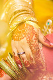 Indian brides decorated hands with tattoos and gold ornaments stock images