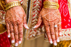 Indian bride with henna painted on arm and hands Royalty Free Stock Photography