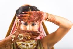 Mehendi or Hena or Hina Indian Bride. An Indian bride posing with Mehendi or Henna an Indian style tattoo stock photos
