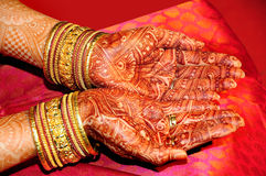 Indian bride's hand. Decorated with mehandi Stock Image