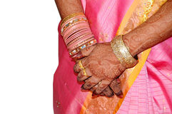 Indian bride's hand. Hands of an Indian bride adorned with jewelery, bangles and painted with henna Royalty Free Stock Photos