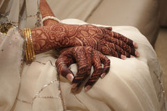 Indian bride's hands covered in henna Stock Images